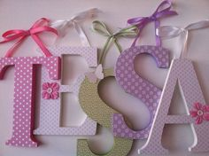 Wooden  nursery letters in  lavender, pink,  and green coordinates with Pottery Barn Camille bedding alphabet initials monogram. $16.00, via Etsy.