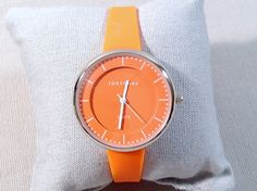 Futuristic and fun, this orange watch is perfect for spring. Bean Orange Watch