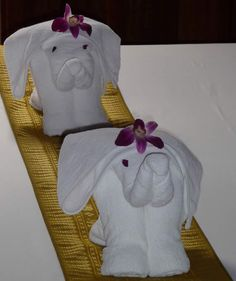 Towel Origami. I like these with the flowers on their heads. http://foldingmagic.com