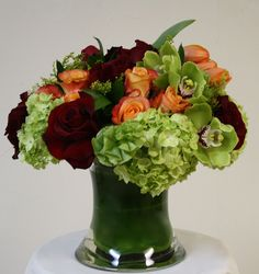 Alexis: A romantic bouquet of Red and Circus Roses, Green Cymbidium Orchids, and Hydrangea.