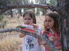 fall nature crafts for kids: tree branch weaving! So cool | via Ergani Weaving on Flickr
