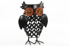 Get your home ready for Halloween with this classic owl decoration. Covered in black and gold glitter this is a great way to transform dreary decor in to something fun!
