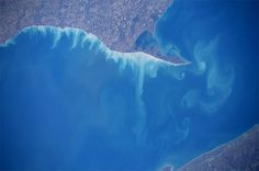Amazing photos of Earth from the International Space Station; Lake Erie was attempting to draw Cape Cod shapes in its eddies near Long Point Provincial Park #Ontario #Canada(Photo & Caption: Reid Wiseman, NASA)