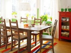 STORNÄS grey-brown extendable table seats 4-6 with KAUSTBY grey-brown chairs and HEMNES red linen cabinet