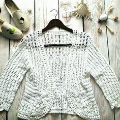 "Boutique crocheted sweater. L. Open front. White. Beautiful crochet lace sweater. Open front. Bust: 18"" Length: 21"" Sleeve: 18"" White. Lrg Mint condition. Boutique Sweaters"