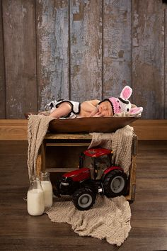 Julie and JW Ashton share this picture of their son Jacob. When deciding what Jacob would wear for his newborn photos, they wanted to feature the most important things in their life - Holsteins, milk and Case IH tractors! Julie grew up on Lindale Holsteins, Hampshire, IL and JW's family grain farms in central Illinois.
