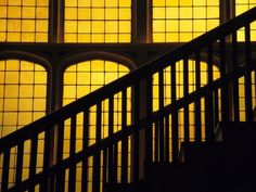 Photographic Print: A Staircase in Silhouette against a Yellow Stained Glass Window by David Evans : Franz Marc, Tomoe, Slytherin, Hogwarts, Era Taisho, The Wolf Among Us, Hells Kitchen, Kill Bill, Mellow Yellow