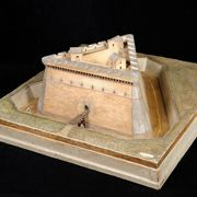 This relief model represents a triangular outwork, or ravelin, for the military defence of the entrance to a fortress. The drawing of the ravelin shown here was probably inspired by a feat of architecture already existing. It dates back to the period when Leonardo was in Romagna to oversee Cesare Borgia's fortifications. The model shown here, which is in the shape of a triangle, has three small service buildings on top.