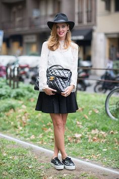 Milan Fashion Week spring 2014, Street style. Long-sleeved lace blouse, black flared mini skirt, grey fedora hat, big quilted Chanel handbag in dark grey, platform flats in grey and white. Very cool!