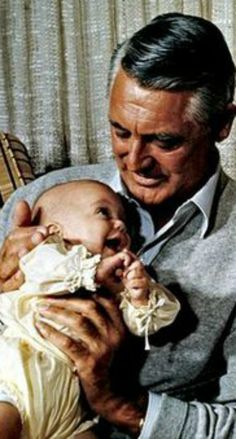 Cary Grant with baby daughter, Jennifer. https://www.magnumphotos.com/Catalogue/Philippe-Halsman/1966/Cary-Grant-British-Actor-NN11349915.html #CaryGrant #celebrities
