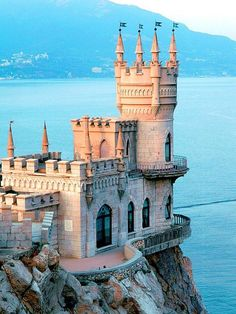 """Swallow's Nest Castle built between 1911-1912 sits on the Aurora Cliff overlooking the Cape of Ai-Todor, Russia. The castle is small according to castle standards, it measures 33' x 66'. Prior to 1911 it was a wooden cottage named """"Castle of Love""""."""