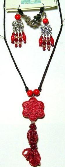 http://www.bonanza.com/listings/24KGP-Carnelian-Carved-Cinnabar-Hand-Beaded-Tassle-Gold-Link-Necklace-Earri/103631913