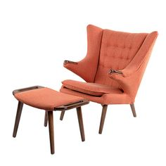 Inspired by one of the mid century icons Hans Wegner's Teddy Bear Chair, the Bjorn Chair is the perfect exemplar that combines the old school aesthetics with timeless design. The lively and animated design combined with the ottoman, sets the gold standard for comfort and compliments every taste or design scheme.Material: Solid Ash Wood Walnut Finish Material: Woven Blend Fabric Color: Retro Orange Dimensions:W 32 x D 28 x H 40 Seat Height: 16 Arm Height: 25 Cushion Dimensions: H 3.5 Ottom...