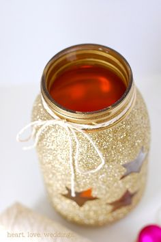 Our DIY gold glitter mason jars make a beautiful Christmas centerpiece that will glow like the stars on a crystal clear winter's night.