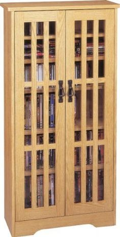"Leslie Dame inlaid glass door, oak by Leslie Dame Enterprises. $179.95. Color: Oak. Two tempered glass door panels with vintage style handles make for dust-free media storage.. Size: 47.75"" H x 24.5"" W x 9.5"" D. All six shelves are adjustable so you can customize your media storage.. Store and preserve up to 371 CDs or 185 DVDs or 100 VHS Videocassettes.. This gorgeous multimedia cabinet is an ideal CD/DVD storage solution for adults and those looking for a contemporary fu..."