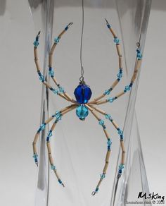 Blue bead spider with bamboo bugle beads.