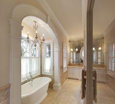 Arch accenuates tub in Master Bath traditional bathroom