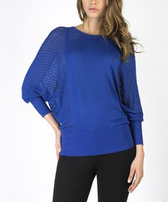 A comfy classic, this subtle sweater features dolman sleeves and ribbed hems. It's a versatile wardrobe addition that's great for layering.
