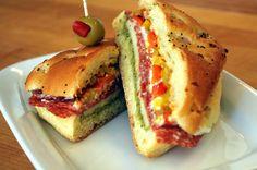 """Picnic Sandwich""  sun dried tomatoes,olive tapenade, onion roll or ciabatta,cream cheese, Boursin,basil pesto,provolone or pepper jack cheese,salami,banana or pepperoncini pepper,red onion"