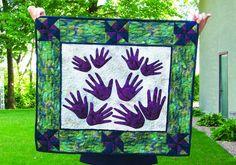 quilt with grandchildren's handprints.jpg