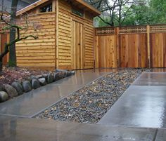 Pebble & Concrete Strip Driveway - This driveway is a great solution for multi car parking whist leaving a walkway area for pedestrians. >> Click for more Driveway Ideas!