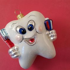 Look Mom...no cavities.  Glass Christmas ornaments.  Tooth, first tooth. www.vintagetreasures-ornaments.com