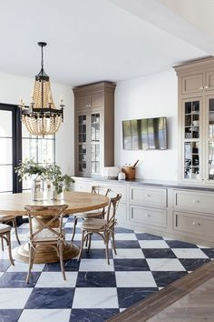 Dining Room Hutch classic yet unexpected black and white checkered marble flooring and the custom hutch cabinet with Soapstone countertop Dining Room Hutch Dining Room Hutch #DiningRoom #DiningRoomHutch