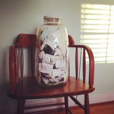 """""""This is my memory jar. I tore and cut out things I found in my journals, sketchbooks, old cards, letters and school papers. This is a jar of my happiest documented memories."""""""
