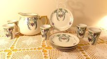 1920s Hand-painted porcelain plates cups and pitcher have Love Birds on grape vines design gold trim