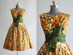 This 1950s party dress features a gorgeous floral print in the prettiest Autumn colors. Fitted waist with full pleated skirt. The waist is