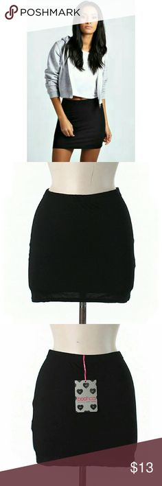 """NWT Boohoo Black Bodycon Mini Skirt Brand new with tags. Classic sexy bodycon mini skirt. Slip-on fit. Approx. 14"""" length. 95% Viscose/5% Elastane. By Boohoo Boutique. Sz 6 US.   Please check out my closet for more NWT items to bundle with discount and save more with combined shipping. Boohoo Skirts Mini"""
