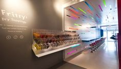 The custom acrylic bulk candy bar of endless variety is integrated into the main candy-coloured volume at Fritzy's frozen yogurt shop in Toronto by Prototype Design Lab. Commercial Interior Design, Shop Interior Design, Commercial Interiors, Pharmacy Design, Retail Design, Candy Store Design, Smoothie Shop, Yogurt Bar, Frozen Yogurt Shop