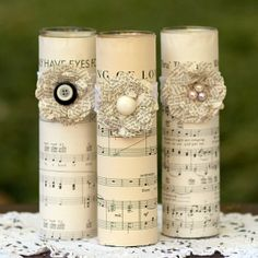 Use dollar store candles and old sheet music, make burlap flower.