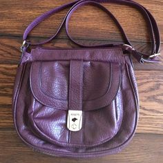 Purple Crossbody Bag Tons of pockets to keep you organized. Adjustable strap. Man made materials but feels like real leather Rosetti Bags Crossbody Bags