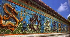 Detail of the Nine-Dragon Wall at the Forbidden City, in Beijing. Description…