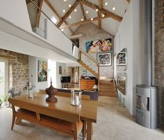 A contemporary look gives makes this beautifully restored stone barn in Somerset something special.