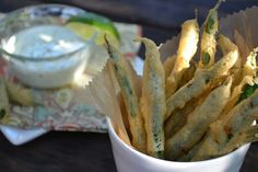 Not a fan of green beans, but we may just have to try this: Fried Green Beans with Lime Aioli Dipping Sauce