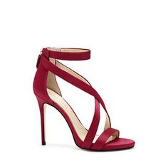 """Imagine Vince Camuto Devin – Satin Crisscross-Strap Sandal-Rise to the occasion in the Imagine Vince Camuto Devin sandal. Parading crisscross straps across the center is an easy way to grant timeless glamour to a satin sandal.  A toe and stretchy ankle strap add security to the svelte heel. Solid colors and smooth fabric pleasantly offset a dress that already has a lot to offer.  <li> 4.25"""" heel height  <li> Fabric upper, man-made lining, leather sole <li> Back zip closure <li> Imported"""