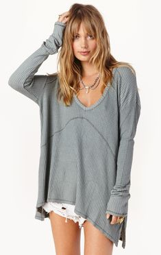 """Lounge around without losing your style in Free People's Sunset Park Top. The drippy thermal comes in a textured stretch fabric with seamed detailing, a swing silhouette and subtle Hi-Lo hem. Perfect for post workout wear or a lazy Sunday around the house. Made in VietnamHand Wash Cold95% Rayon 5% SpandexFit Guide:Model is 5ft 9 inches; Bust: 33"""", Waist: 24"""", Hips: 34""""Model is wearing a size SRelaxed fit"""