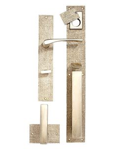 Smooth handles and locks meet strikingly textured plates in the Burlap hardware collection by Sun Valley Bronze.