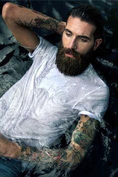 Water and bearded goodness in white tshirt
