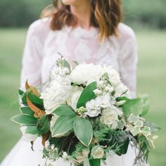 For a fresh twist on a spring bouquet, go green! Love the magnolia leaves tucked into this one, too. Bouquet by @FloressenceFlowers and photo by @CheyenneSchultz. http://southernweddings.com/2017/01/16/lonesome-valle