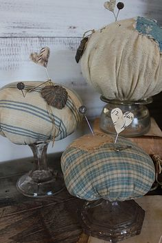 cinnamon creek dry goods | HANDMADE | SOLD Pinkeeps Make do pin keeps made from vintage cloth with sweet little pins . Blue & Cream stripe ( far left ) 6'' tall…… 28.00 Blue & cream homespun pin keep ( 4'' tall )…..SOLD 24.00 Solid cream homespun with blue calico patch ( back) 6'' tall….. SOLD 28.00
