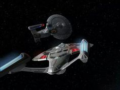 USS Sovereign (NX-73811) approaching a badly damaged Galaxy class starship