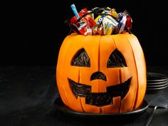 Make a Halloween cake that looks just like a pumpkin candy bucket from Food Network Magazine.