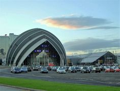 Clyde Auditorium by Norman Forster, Glasgow Scotland has great curves using the shell shape.