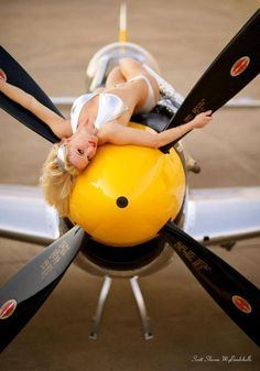 provocative aviation #pinup gal on nose of aircraft