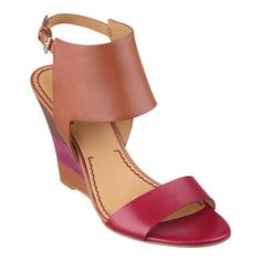 """Definitely fashion forward, Melondy's colorblocking revises a dramatic sandal lifted by multi-colored stacked wedge heels. Adjustable buckle closure. Leather upper. Padded footbed for all-day comfort. Leather upper. Man-made lining and sole. Imported. 3 3/4"""" heels. Wedge sandals."""