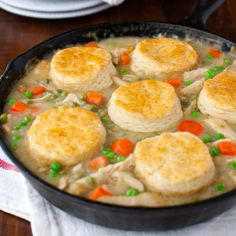 Chicken pot pie - a creamy filling of chicken and vegetables topped with flaky biscuits.