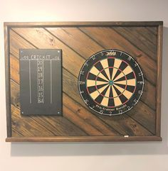 man cave garage A great addition to your Game Room, Garage, Patio or Man Cave, this Dart Backboard is X It is custom made in a variety of stains and adds style and decor to yo Man Cave Garage, Garage Gym, Garage Walls, Garage Shop, Man Cave Designs, Bar Designs, Biker Bar, Game Room Basement, Man Cave Basement